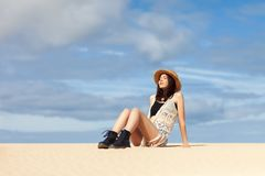Beautiful young woman relaxing on sand. Fashion portrait royalty free stock images