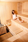 Beautiful Young Woman Relaxing In Sauna Royalty Free Stock Photography