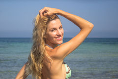 Beautiful young woman relaxing on sea beach, portrait, face Royalty Free Stock Photo