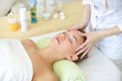 Beautiful young woman relaxing in the spa salon Stock Photos