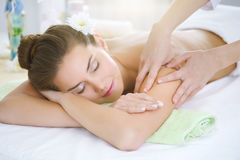 Beautiful young woman relaxing in the spa salon Royalty Free Stock Photo