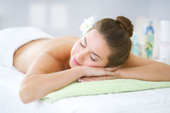Beautiful young woman relaxing in the spa salon Stock Images