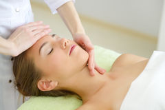 Beautiful young woman relaxing in the spa salon Royalty Free Stock Image