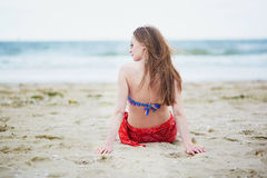 Beautiful young woman relaxing and sunbathing on beach Stock Photography
