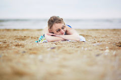 Beautiful young woman relaxing and sunbathing on beach Royalty Free Stock Photo