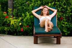 Beautiful young woman relaxing on sunbed Royalty Free Stock Images