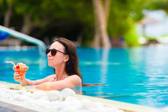 Beautiful young woman relaxing in the swimming Stock Photos