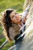 Beautiful young woman relaxing under a hay stack Stock Photos