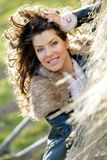 Beautiful young woman relaxing under a hay stack Stock Images