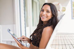 Beautiful young woman relaxing and using tablet pc Stock Photos