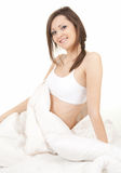 Beautiful young woman relaxing in white bedding Royalty Free Stock Photos
