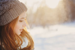Beautiful young woman relaxing on winter walk in snowy forest, candid capture Stock Photography