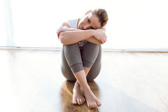 Beautiful young woman relaxing after a workout at home. Royalty Free Stock Photography