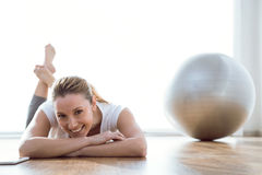 Beautiful young woman relaxing after a workout at home. Stock Image