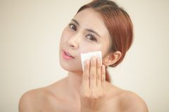 Beautiful young woman removing her make up. royalty free stock photography