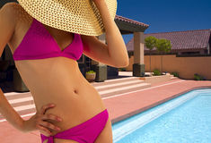 Beautiful young woman at resort hotel pool Stock Image