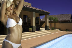Beautiful young woman at resort hotel pool royalty free stock photography