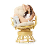 Beautiful young woman resting in armchair. Royalty Free Stock Photography