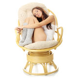 Beautiful young woman resting in armchair. Royalty Free Stock Image