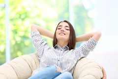 Beautiful young woman resting on armchair. In hotel Royalty Free Stock Photo