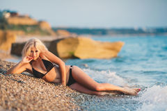A beautiful young woman resting on the beach. Stock Photography