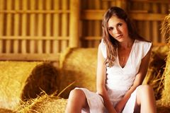 A beautiful young woman is resting on the hay Royalty Free Stock Image