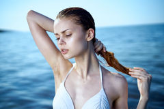 Beautiful young woman is resting on the sea, beach, sun, summer, ocean Stock Photography