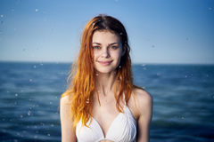 Beautiful young woman resting on the sea, ocean, beach, summer, sun Stock Image