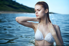 Beautiful young woman is resting on the sea, ocean, beach, summer, sun, light, relaxation Stock Photo
