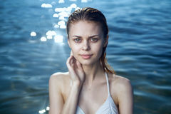 Beautiful young woman is resting on the sea, ocean, beach, sun, summer Stock Image