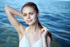 Beautiful young woman is resting on the sea, ocean, beach, sun, summer Stock Photography