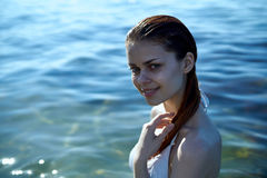 Beautiful young woman is resting on the sea, ocean, beach, water, vacation Royalty Free Stock Photo