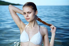 Beautiful young woman is resting on the sea, ocean, beach, water, vacation Stock Image