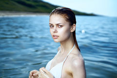 Beautiful young woman is resting on the sea, summer, ocean Royalty Free Stock Images