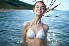 Beautiful young woman is resting on the sea, summer, ocean Royalty Free Stock Photography