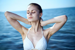 Beautiful young woman resting on the sea, water, beach, ocean, vacation Royalty Free Stock Photo