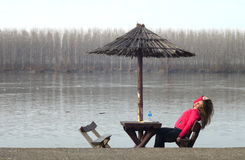 Beautiful young woman rests by the river Danube in Serbia Royalty Free Stock Image