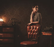 Beautiful young woman in retro interior.  royalty free stock image