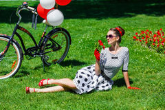 Beautiful young woman retro pin-up style with bicycle Royalty Free Stock Image