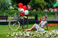 Beautiful young woman retro pin-up style with bicycle Royalty Free Stock Photos