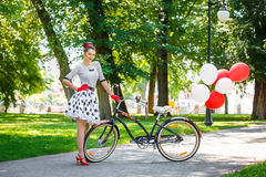 Beautiful young woman retro pin-up style with bicycle Stock Photography