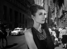 Beautiful young woman in retro style in old town. Like hepburn audrey stock images