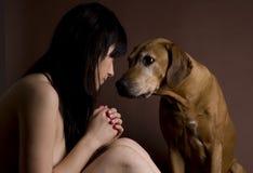 Beautiful young woman with Rhodesian Ridgeback dog stock image