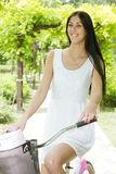 Beautiful young woman ride bicycle Royalty Free Stock Image