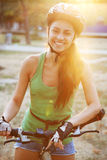 Beautiful young woman riding a bicycle Royalty Free Stock Photo