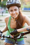 Beautiful young woman riding a bicycle Royalty Free Stock Photography