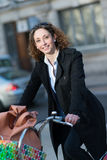 Beautiful young woman riding bicycle Royalty Free Stock Images