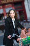 Beautiful young woman riding bicycle Stock Image