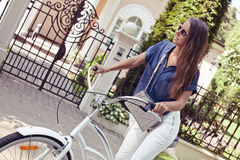Beautiful young woman riding bicycle. Stock Photography