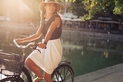 Beautiful young woman riding a bicycle Royalty Free Stock Images